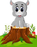 Cartoon rhino sitting Stock Images