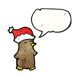 Cartoon robin in santa hat Royalty Free Stock Photo