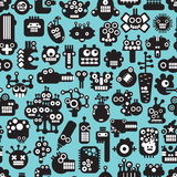 Cartoon robots faces. Cartoon robots faces seamless pattern on blue. Vector background Royalty Free Stock Images