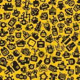Cartoon robots faces seamless pattern on yellow. Vector retro background vector illustration