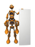 Cartoon robots holding blank sign. Royalty Free Stock Photo