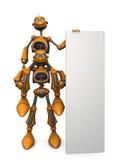 Cartoon robots holding blank sign. Royalty Free Stock Photo