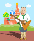Cartoon russian character with balaika at Moscow Stock Image