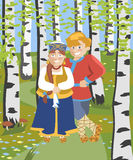 Cartoon russian couple in folk costumes at birch grove Royalty Free Stock Photos