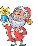 Cartoon Santa with a christmas gift Royalty Free Stock Photos