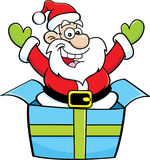 Cartoon Santa Claus jumping out of a gift box. Stock Image