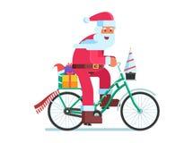 Santa with Gift Bag on Christmas Bike Royalty Free Stock Image