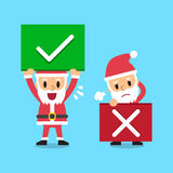 Cartoon santa claus with right and wrong signs Royalty Free Stock Photos