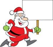 Cartoon Santa Claus running while holding a sign. Stock Photos