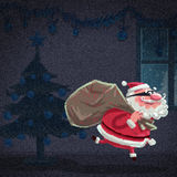 Cartoon Santa Claus thief is stealing a house at christmas Royalty Free Stock Photo