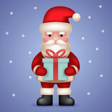 Cartoon Santa Claus Toy Character Hold Present Stock Photos