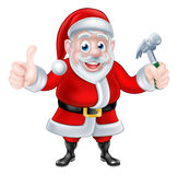 Cartoon Santa Giving Thumbs Up and Holding Hammer Royalty Free Stock Image