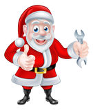 Cartoon Santa Giving Thumbs Up and Holding Spanner Royalty Free Stock Photos