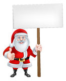 Cartoon Santa Holding a Sign Stock Photos
