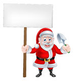 Cartoon Santa Holding Sign and Trowel Royalty Free Stock Photography