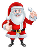 Cartoon Santa Holding a Spanner Royalty Free Stock Image