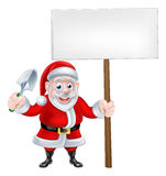 Cartoon Santa Holding Trowel and Sign Royalty Free Stock Image