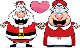 Cartoon Santa and Mrs Claus Love Royalty Free Stock Photos