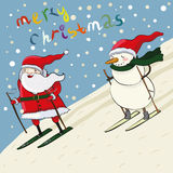 Cartoon santa and snowmen ski Stock Image
