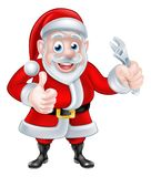 Cartoon Santa Thumbs Up and Holding Wrench Spanner Stock Images