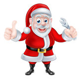 Cartoon Santa Thumbs Up and Holding Wrench Spanner Stock Photos