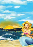 Cartoon scene of sitting mermaid on the beach near the ocean - looking at sunset or sunrise Royalty Free Stock Images