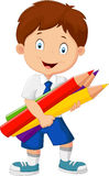 Cartoon school boy holding colorful pencils Stock Photo
