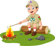 Cartoon scout roasting marshmallow Stock Photos