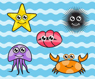 Cartoon sea creatures. On blue sea background Royalty Free Stock Photography