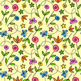 Cartoon seamless pattern with flowers and butterflies. On a yellow background Stock Image