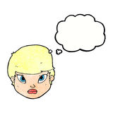 Cartoon serious face with thought bubble Royalty Free Stock Photo