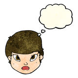 Cartoon serious face with thought bubble Royalty Free Stock Photography