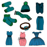 Cartoon set of clothes. Vector illustration. Drawing by hand. Stock Photos