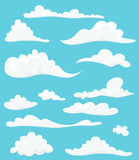 Cartoon set of cute clouds on blue background Royalty Free Stock Photos