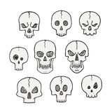 Cartoon set of skulls. Scary and halloween collection Stock Photos