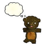 cartoon shocked black bear cub with speech bubble Royalty Free Stock Images