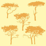 Cartoon silhouette of different trees in ochre tones. Cartoon brown silhouette of different trees in ochre tones stock illustration