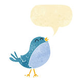 Cartoon singing bird with speech bubble Stock Photo