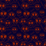 Cartoon skulls in blue and orange, halloween seamless pattern, vector Stock Photo