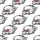 Cartoon skulls with tribal flames seamless pattern Stock Photos