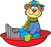 Cartoon sledding bear Stock Photo