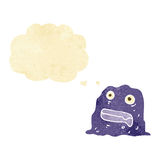 Cartoon slime creature with thought bubble Stock Photos