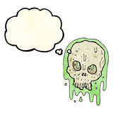 Cartoon slimy skull with thought bubble Royalty Free Stock Image