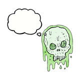 Cartoon slimy skull with thought bubble Stock Image