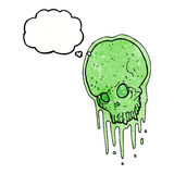 Cartoon slimy skull with thought bubble Stock Photo