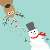 Cartoon Snowman and deer. Blue background. Candy cane. Merry Christmas card. Flat design Stock Photos