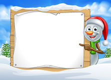 Cartoon Snowman Santa Hat Sign Scene Royalty Free Stock Photo