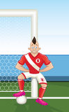 Cartoon soccer player leaning on goalpost Royalty Free Stock Photo