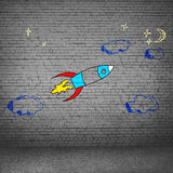 Cartoon space rocket. Illustration image with drawn on wall flying rocket Royalty Free Stock Images