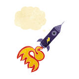 cartoon space rocket with thought bubble Royalty Free Stock Photography